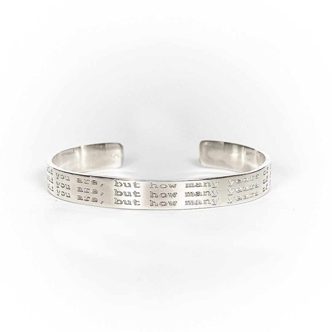 "Bangle in silver with engraving ""Age is not"""