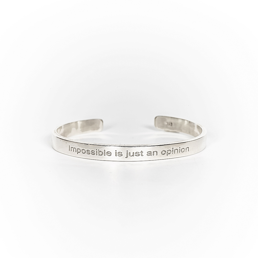 Bangle in silver with engraving « Impossible is just an opinion »