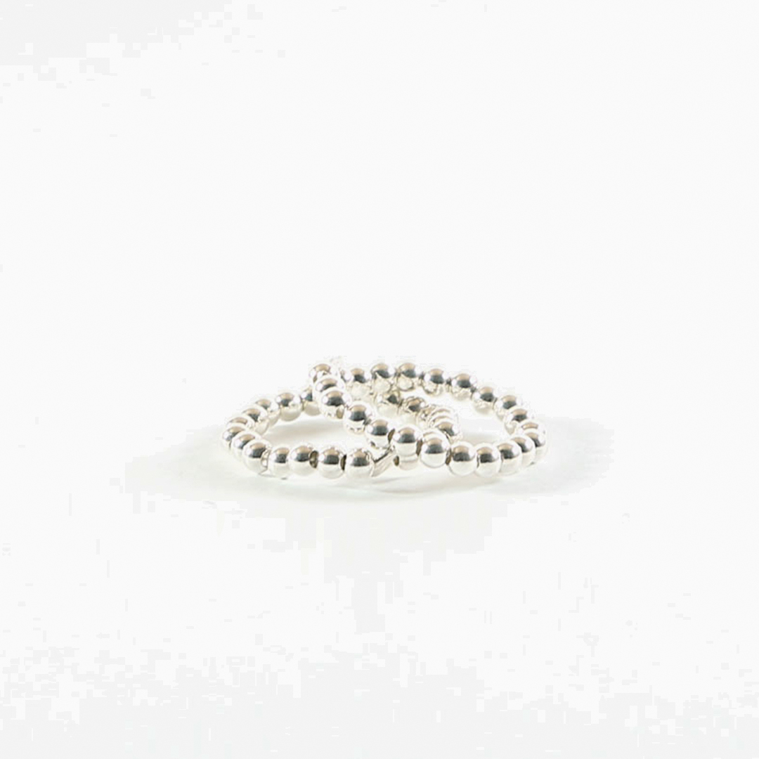 Duo of elasticated rings with silver beads