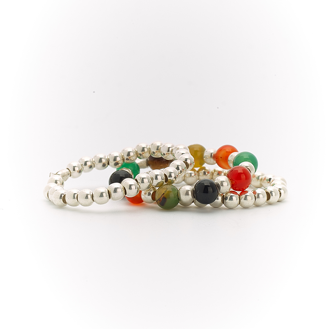 Trio of silver and multicoloured gemstone rings