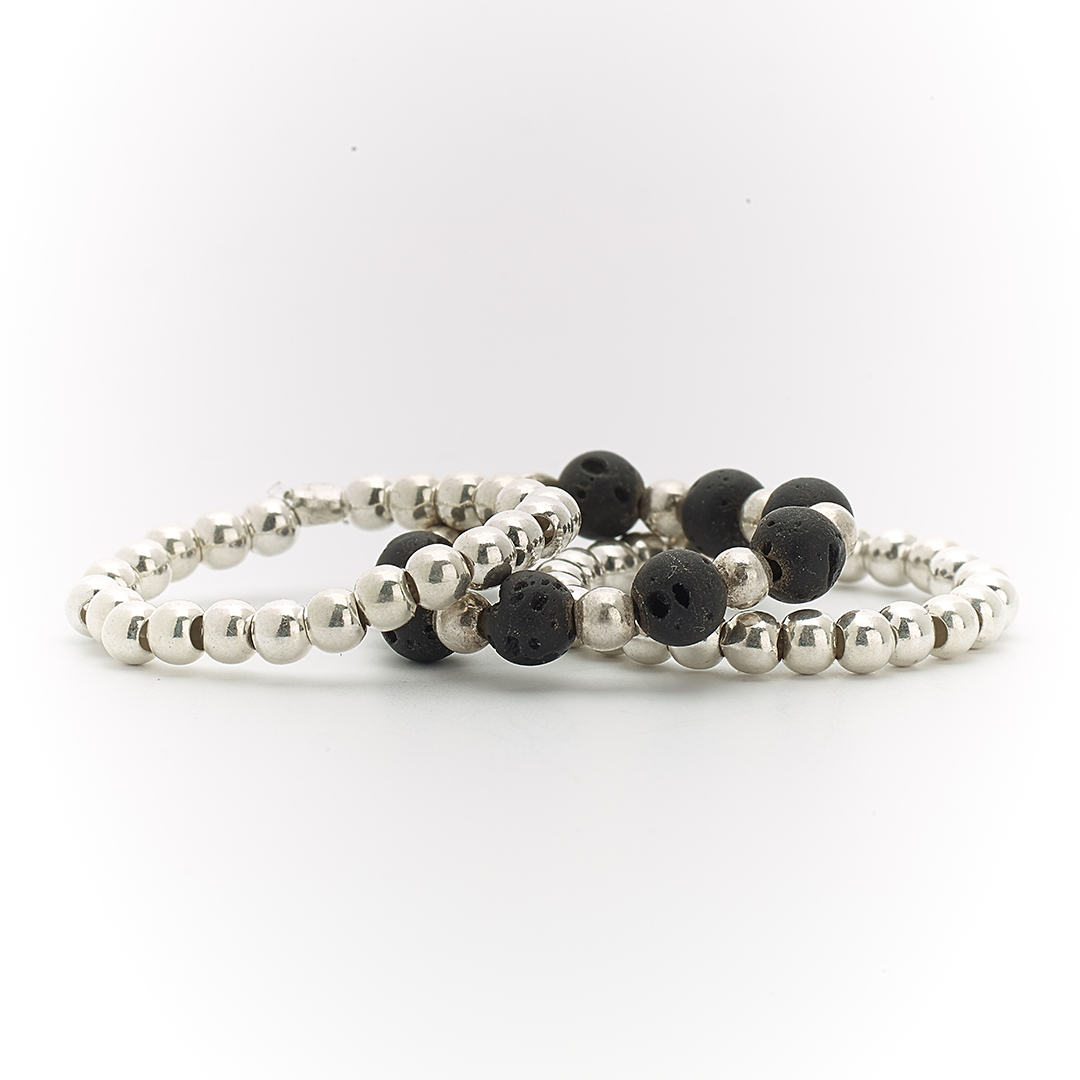 Trio of silver and lava stone rings