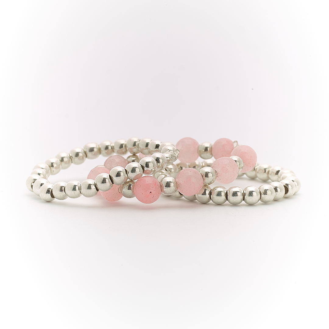 Trio of silver and rose quartz rings