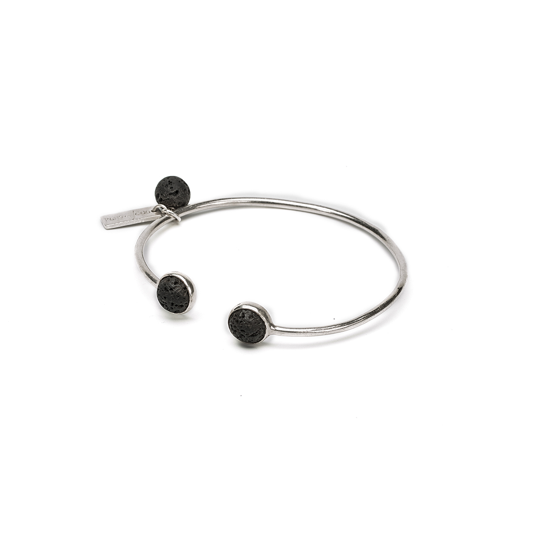 Solid silver bangle with black lava stones