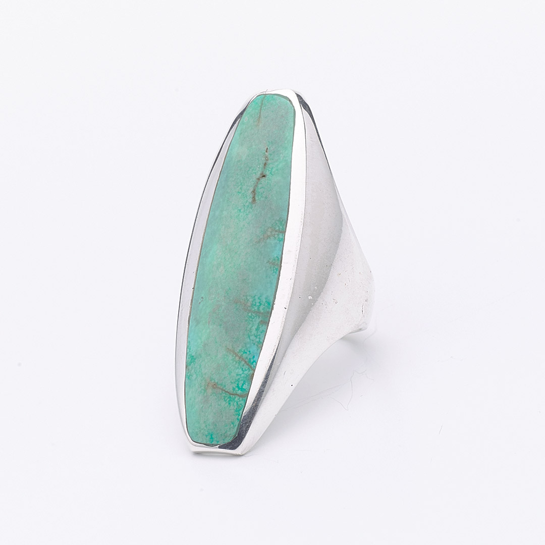 Long silver ring with turquoise stone