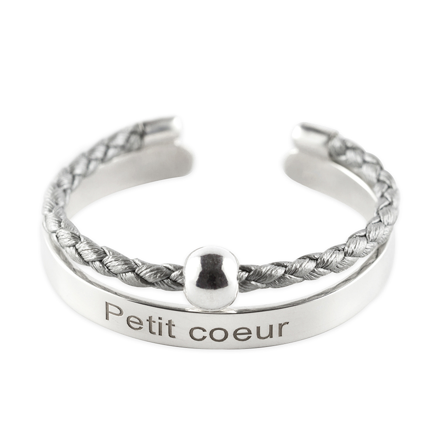"""Child's solid silver bangle with inscription """"Petit Coeur"""" and silvery grey leather cord"""