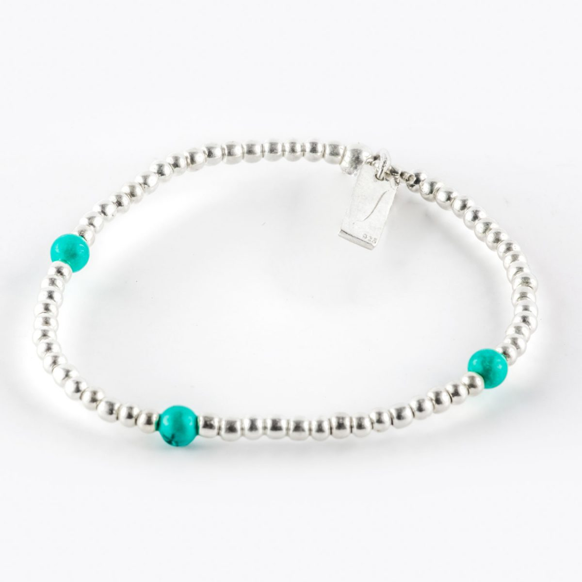 Child's Elasticated Bracelet with solid silver beads and 3 turquoise beads