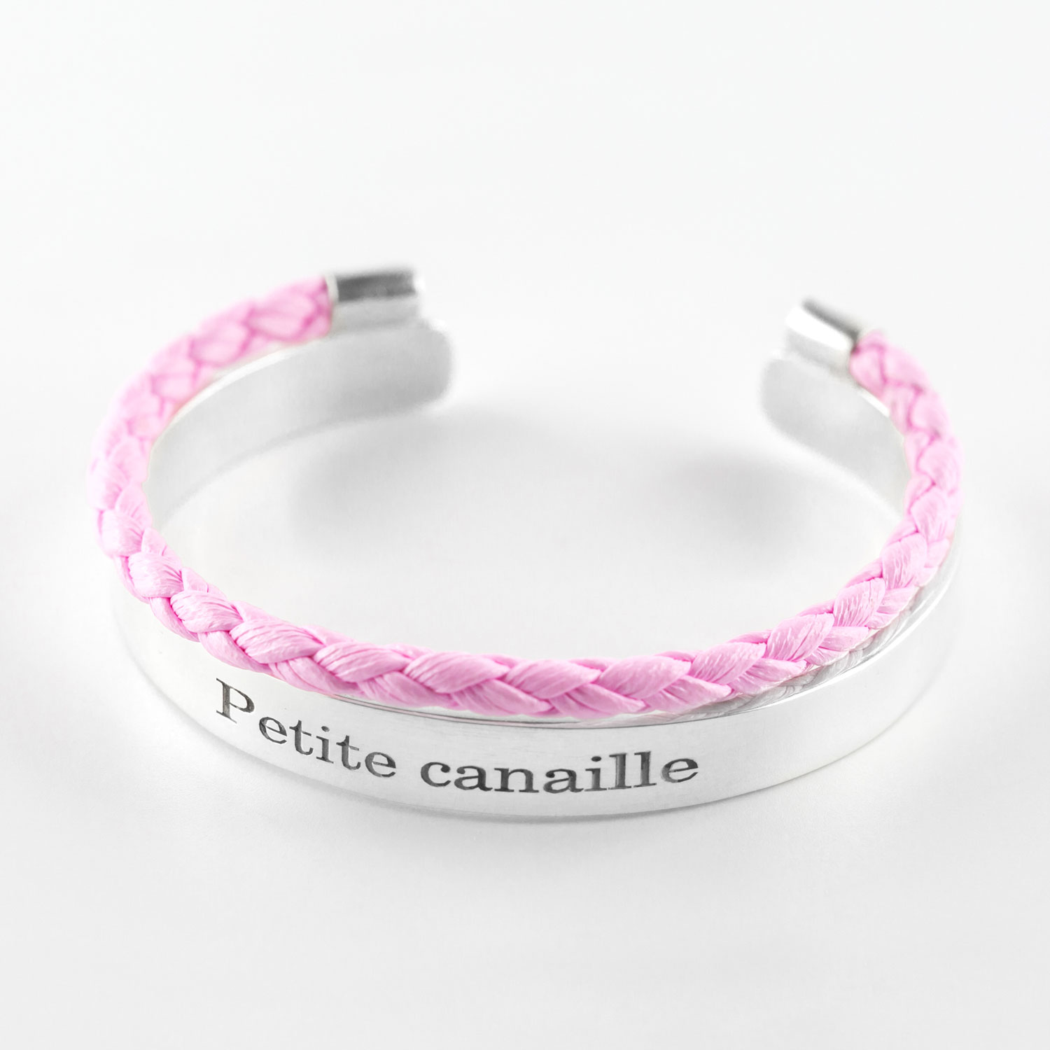 "Child's solid silver bangle with inscription ""Petite canaille"" and pink leather cord"