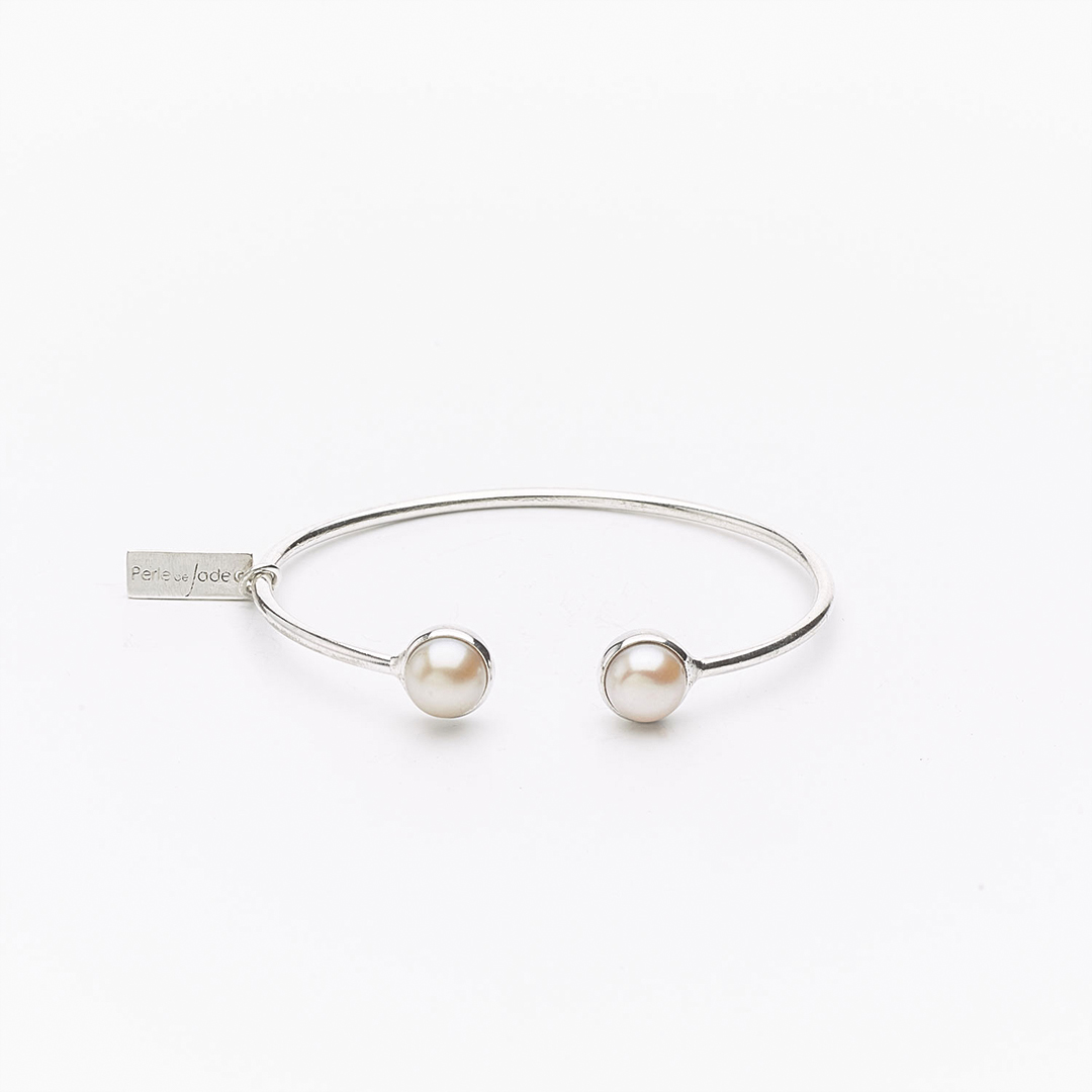 Solid silver bangle with white cultured pearl beads